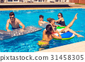 Men and women playing in the pool with swimming 31458305