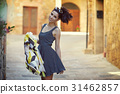 attractive woman tourist with hat in old italian town 31462857