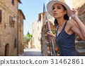 attractive woman tourist with hat in old italian town 31462861
