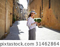 attractive woman tourist with hat in old italian town 31462864