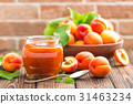 Apricot jam in a jar and fresh fruits with leaves 31463234