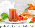 Apricot jam in a jar and fresh fruits with leaves 31463241