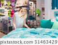 Woman choosing the right item for her apartment in 31463429