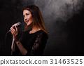 Singing brunette background of smoke 31463525