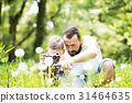 Young father with little boy with camera in summer 31464635