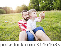 Hipster father and little son on green meadow 31464685