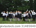 young boys and girls in uniform outdoors 31465640