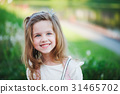 cute little girl in summer park 31465702