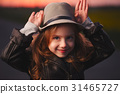 little girl with hat on evening sunset 31465727
