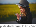 little funny girl with smartphone 31465747
