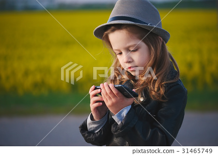 little funny girl with smartphone 31465749