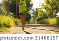 Young fitness woman running on  forest trail 31466157