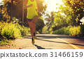 Young fitness woman running on  forest trail 31466159