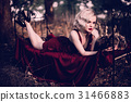 Beautiful and elegant blonde woman with red lips 31466883