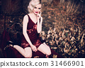 Beautiful and elegant blonde woman with red lips 31466901
