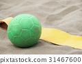 Handball ball on the beach in the sand 31467600