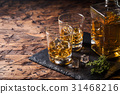 Whiskey with ice in glasses 31468216