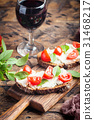 Crostini appetizers with cherry tomatoes, and 31468217