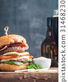 Hamburger and dark beer in vintage style 31468230