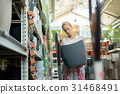Woman choosing the right item for her apartment in 31468491