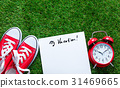 gumshoes, sheet of paper and alarm clock 31469665