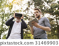 Young man and his senior father with VR glasses 31469903