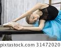 Ballerina posing on table 31472020