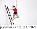 Ballerina on ladder in studio 31472021