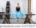 Ballerina sits on table 31472037