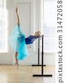 Ballerina is training on barre 31472058