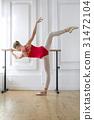 Ballerina is training on barre 31472104