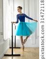 Ballerina is training on barre 31472118