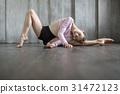 Ballerina posing in studio 31472123