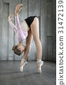 Ballerina posing in studio 31472139