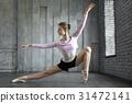 Ballerina posing in studio 31472141
