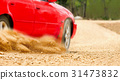 Rally car in dirt track. 31473832