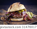 Hamburger with Chili Relish on old Cutting Board 31476017