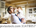 Businessman holding little son in the arms 31478057