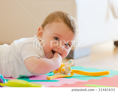 Toddler plays on the floor. 31481633