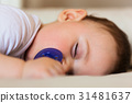 Toddler sleeping on the bed. 31481637