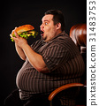 Fat man eating fast food hamberger. Breakfast for 31483753