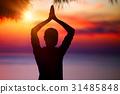 Doing yoga on sunset 31485848
