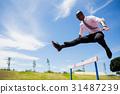 Businessman jumping a hurdle while running 31487239