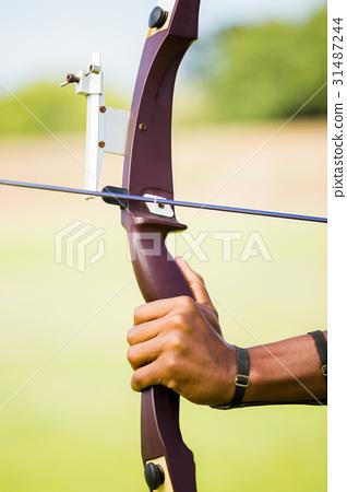Athlete practicing archery 31487244