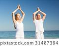Man and woman performing yoga 31487394