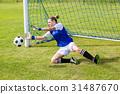 Female goalkeeper saving a goal 31487670