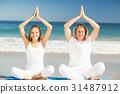 Man and woman performing yoga 31487912