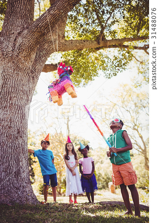 Little boy is going to broke a pinata for his birthday 31488076