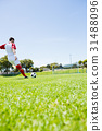 Football player practicing soccer 31488096