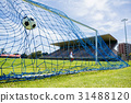 Football hitting the back of net 31488120